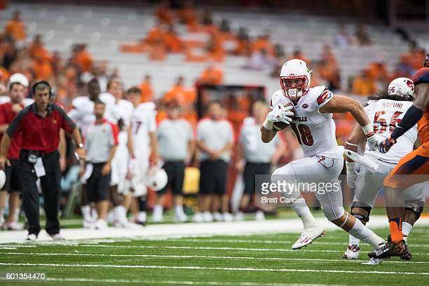 Cole Hikutini of the Louisville Cardinals runs with the ball after a reception during the second half against the Syracuse Orange on September 9 2016...