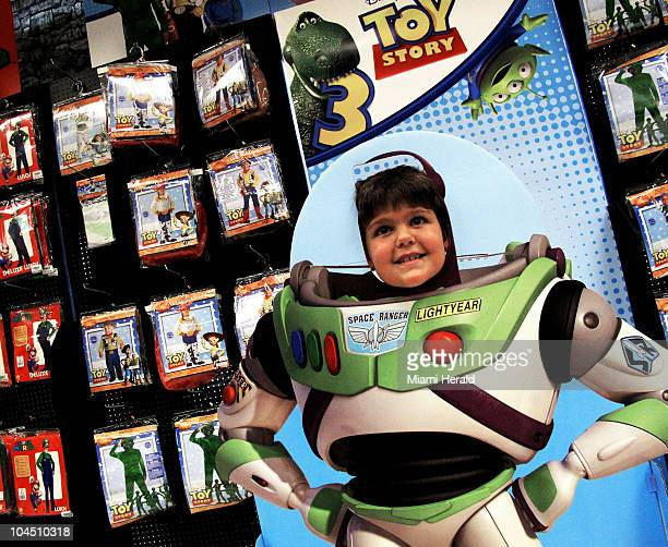 Cole Holifield steps into the 'Buzz Lightyear' standee as he and his brother visit the Spirit Halloween store in Plantation Florida September 21 2010