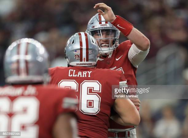 Cole Kelley of the Arkansas Razorbacks celebrates a touchdown with Ty Clary in the second quarter against the Texas AM Aggies at ATT Stadium on...