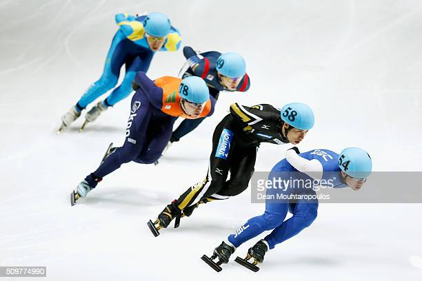 Cole Krueger of the United States of America Ryosuke Sakazume of Japan and Dennis Visser of the Netherlands compete in the mens 1000m Heats during...