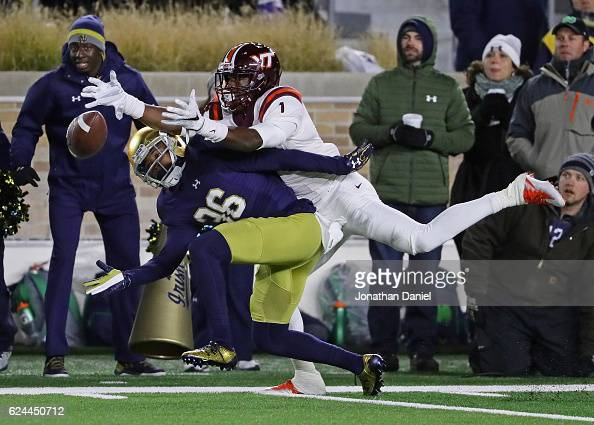 Cole Luke of the Notre Dame Fighting Irish is called for pass interference against Isaiah Ford of the Virginia Tech Hokies at Notre Dame Stadium on...