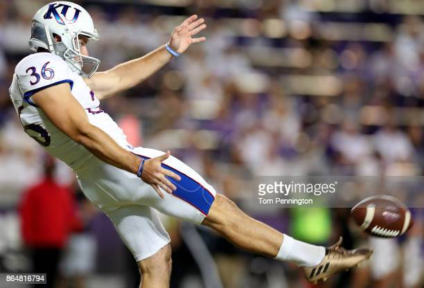 Cole Moos of the Kansas Jayhawks punts the ball against the TCU Horned Frogs in the first half at Amon G Carter Stadium on October 21 2017 in Fort...