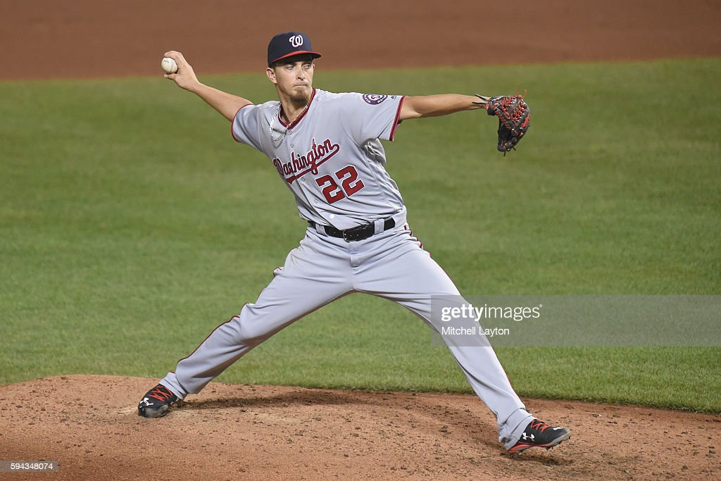A.J. Cole #22 of the Washington Nationals pitches in the fifth inning during a baseball game against the the Baltimore Orioles at Oriole Park at Camden Yards on August 22, 2016 in Baltimore, Maryland.