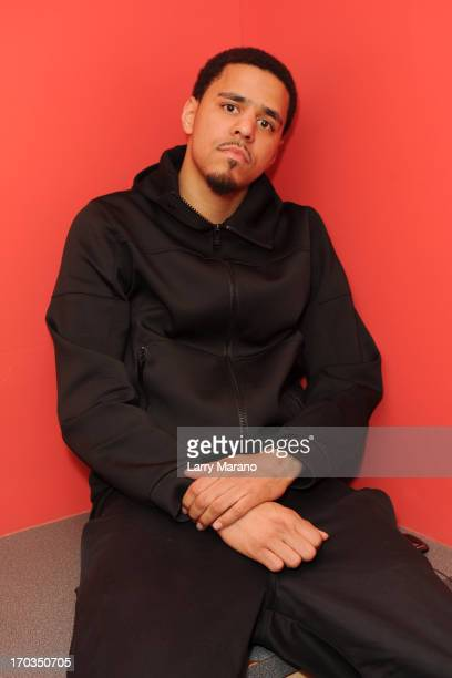 J Cole poses for a portrait at Y 100 Radio station on June 11 2013 in Miami Florida