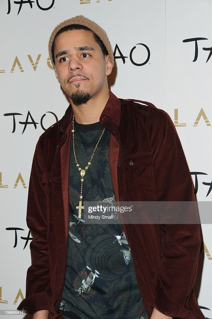 J. Cole rings in the New Year at Tao Nightclub at The Venetian on December 31, 2012 in Las Vegas, Nevada.