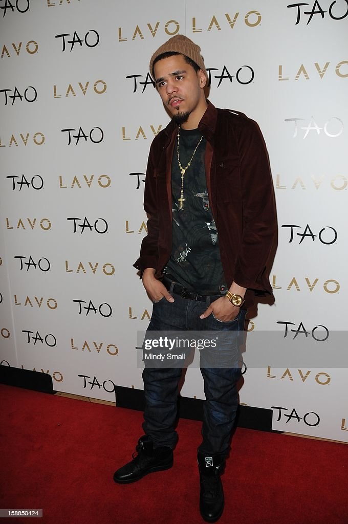 <a gi-track='captionPersonalityLinkClicked' href=/galleries/search?phrase=J.+Cole&family=editorial&specificpeople=5958978 ng-click='$event.stopPropagation()'>J. Cole</a> rings in the New Year at Tao Nightclub at The Venetian on December 31, 2012 in Las Vegas, Nevada.