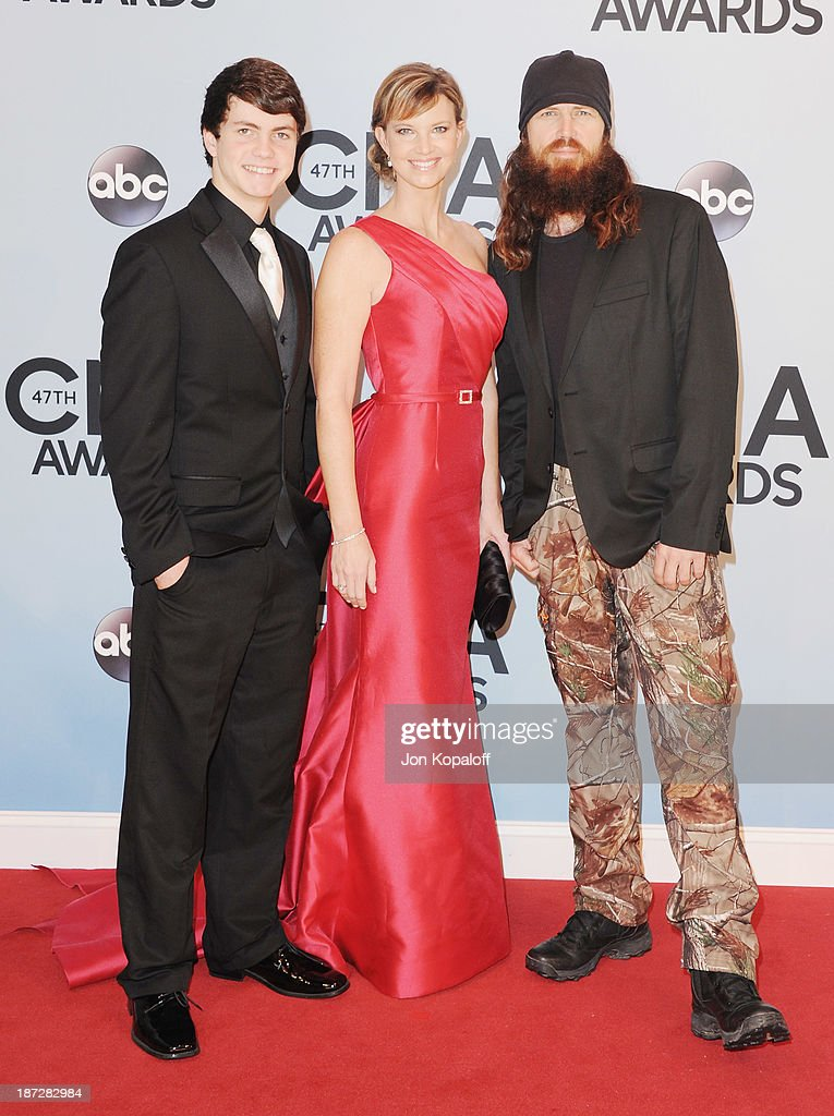 Cole Robertson, Melissa Robertson and Jase Robertson of Duck Dynasty attend the 47th annual CMA Awards at the Bridgestone Arena on November 6, 2013 in Nashville, Tennessee.