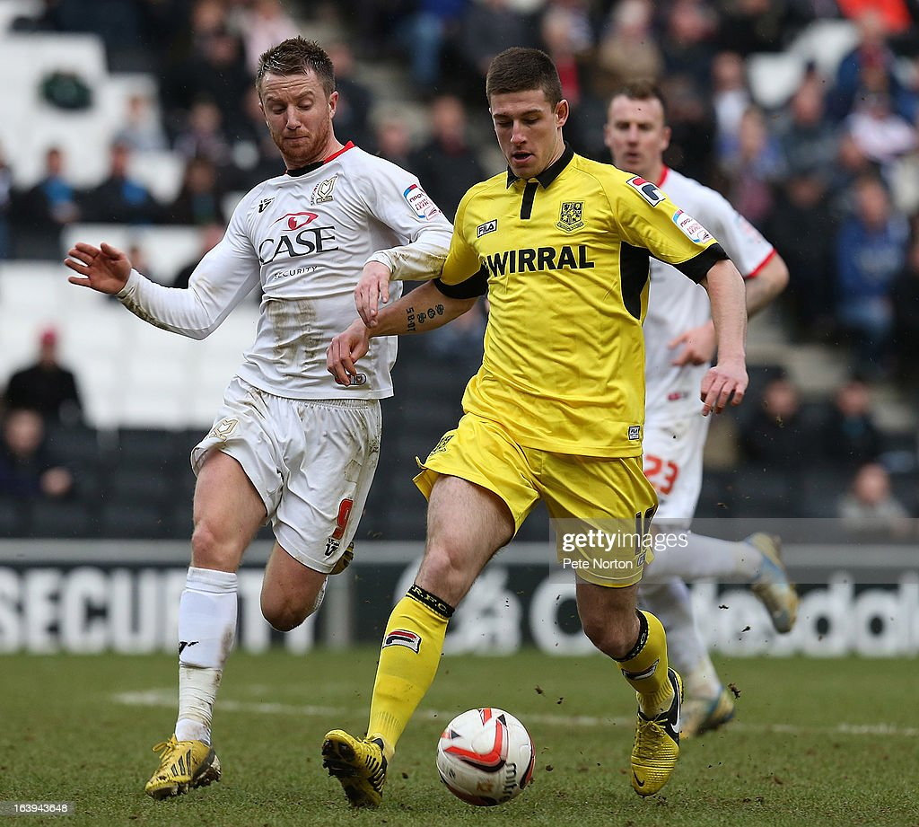 Cole Stockton (R) of Tranmere Rovers controls the ball under pressure from Dean Bowditch of MK Dons during the npower League One match between MK Dons and Tranmere Rovers at Stadium MK on March 16, 2013 in Milton Keynes, England.