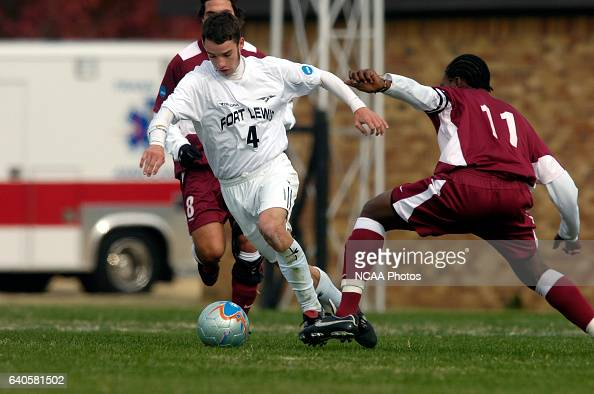 Cole Sweetser of Fort Lewis and Andre Elphic of Franklin Pierce battle for the ball during the Men's Division II Soccer Championship held on the...