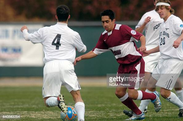 Cole Sweetser of Fort Lewis and Raphael Guimaraes of Franklin Pierce battle for the ball during the Men's Division II Soccer Championship held on the...