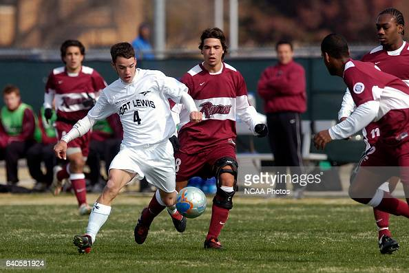 Cole Sweetser of Fort Lewis moves the ball down field while the Franklin Pierce team moves in to stop him during the Men's Division II Soccer...