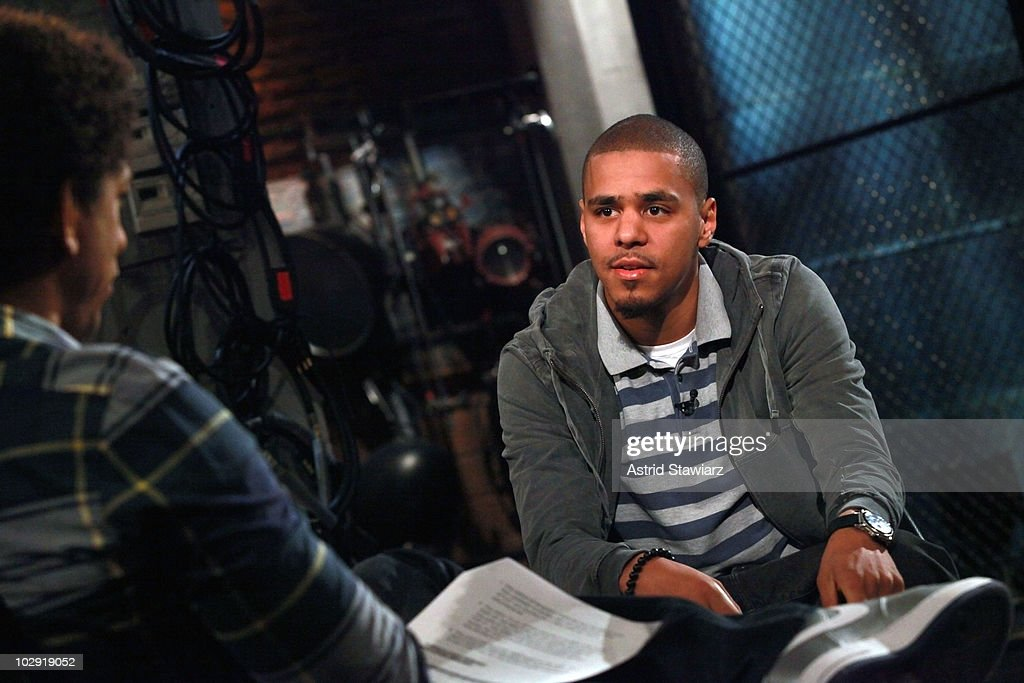 J. Cole (R) visits Fuse's 'Hip Hop Shop' and talks to host Toure (L) during a taping of an episode, airing on July 21, 2010, at fuse Studios on July 15, 2010 in New York City.