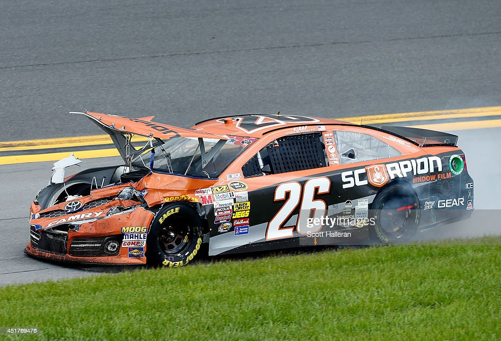 Cole Whitt, driver of the #26 Al's Liner/Scorpion Window Film Toyota, is seen following an incident during the NASCAR Sprint Cup Series Coke Zero 400 at Daytona International Speedway on July 6, 2014 in Daytona Beach, Florida.