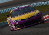 Cole Whitt driver of the Bully Hill Vineyards Toyota practices for the NASCAR Sprint Cup Series CheezIt 355 at Watkins Glen International on August 8...