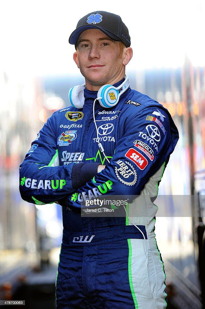 <a gi-track='captionPersonalityLinkClicked' href=/galleries/search?phrase=Cole+Whitt&family=editorial&specificpeople=7046334 ng-click='$event.stopPropagation()'>Cole Whitt</a>, driver of the #26 Gear Speed Stick Toyota, poses between two haulers during practice for the NASCAR Sprint Cup Series Food City 500 at Bristol Motor Speedway on March 14, 2014 in Bristol, Tennessee.