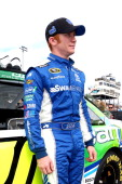 Cole Whitt driver of the Lean 1 Toyota stands on the grid prior to the NASCAR Sprint Cup Series AdvoCare 500 at Phoenix International Raceway on...