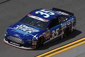 Cole Whitt driver of the Speed Stick Ford practices for the NASCAR Sprint Cup Series Coke Zero 400 at Daytona International Speedway on July 3 2015...