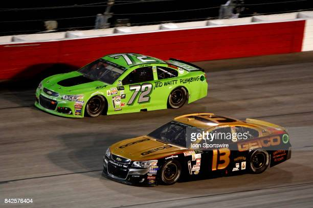 Cole Whitt TriStar Motorsports Ford Fusion and Ty Dillon Germain Motorsports GEICO Chevrolet SS during the Bojangles Southern 500 on September 3 at...