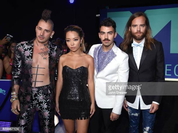 Cole Whittle JinJoo Lee Joe Jonas and Jack Lawless of DNCE attend the 2017 MTV Video Music Awards at The Forum on August 27 2017 in Inglewood...