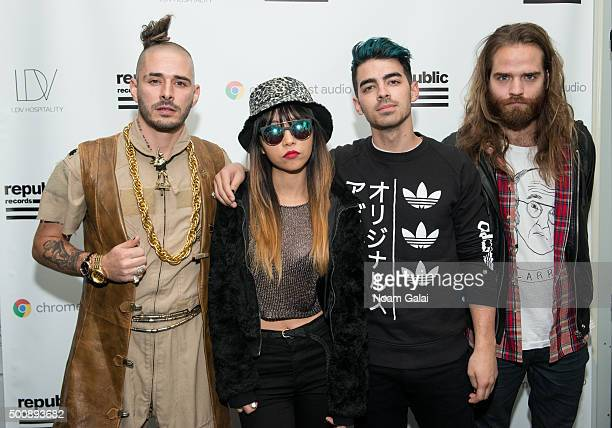 Cole Whittle JinJoo Lee Joe Jonas and Jack Lawless of the band DNCE attend the annual Republic Records holiday party hosted by Ketel One vodka on...