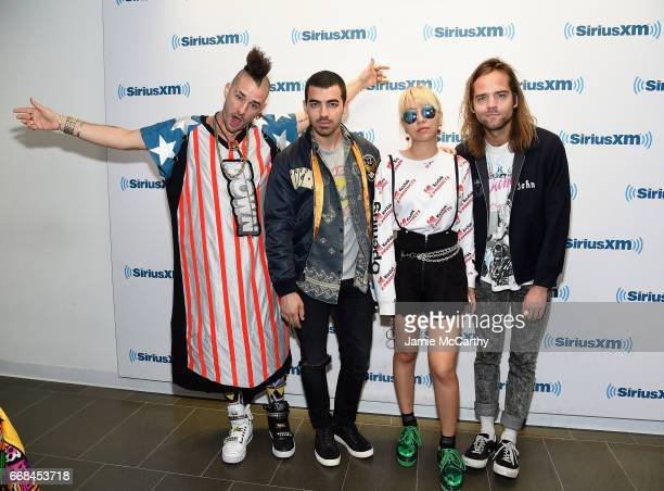 Cole Whittle Joe Jonas JinJoo Lee and Jack Lawless of music group DNCE visit SiriusXM Studios on April 14 2017 in New York City