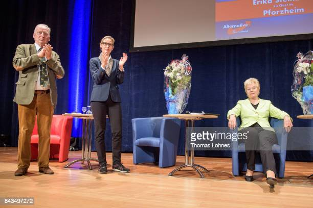 Colead candidates Alice Weidel and Alexander Gauland applaud former Christian Democrat Erika Steinbach after her speech during an AfD election...