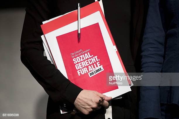 Coleader of Die Linke party Katja Kipping holds a file reading 'The future we fight for social fair for everybody The left' at the end of a news...