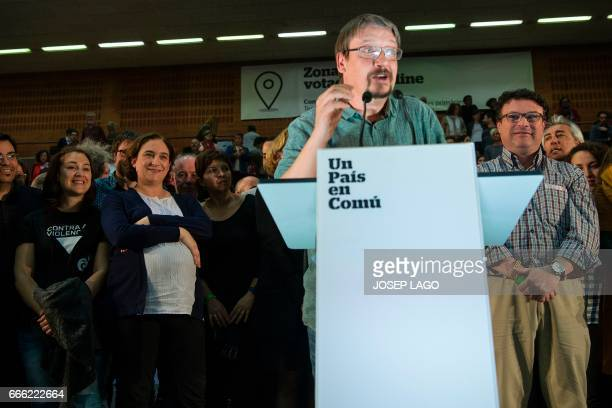 CoLeader of new leftwing party 'Un Pais en Comu' and Mayor of Barcelona Ada Colau looks towards CoLeader of new leftwing party 'Un Pais en Comu'...