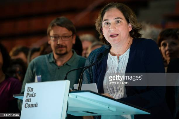 CoLeader of new leftwing party 'Un Pais en Comu' Xavier Domenech looks towards CoLeader of new leftwing party 'Un Pais en Comu' and Mayor of...