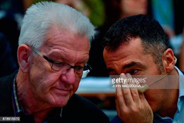 Coleader of the Green party Cem Ozdemir chats with BadenWuerttemberg Premier Winfried Kretschmann during an extraordinary Green party congress to...