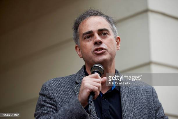 Coleader of the Green Party Jonathan Bartley speaks at a protest against the gig economy in central London on September 27 2017 / AFP PHOTO / NIKLAS...