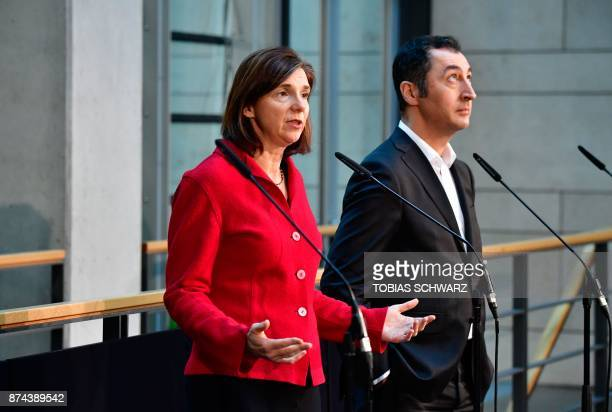 Coleader of the Greens Cem Oezdemir and parliamentary group coleader Katrin GoeringEckardt address journalists prior to further exploratory talks...