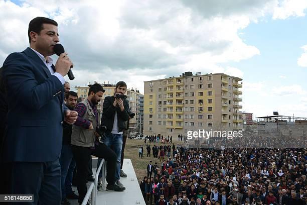 Coleader of the proKurdish Peoples' Democratic Party Selahattin Demirtas speaks as Kurds gather for Nowruz celebrations at Silvan in Diyarbakir...