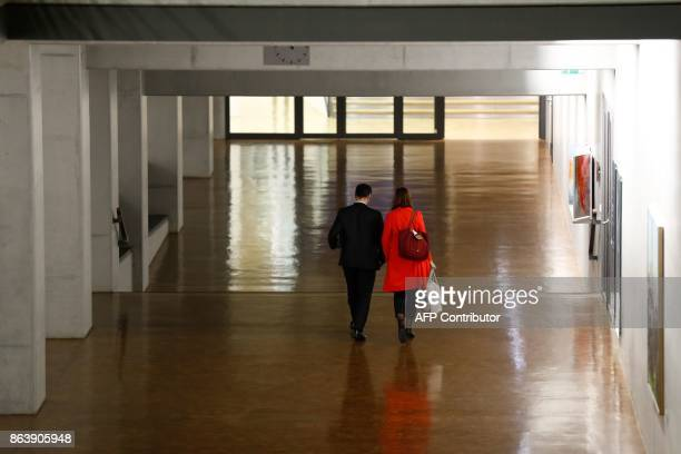 Coleaders of the Germany Greens Party Cem Ozdemir and Katrin GoeringEckardt leave after members of the delegations of the CDU/CSU conservative...