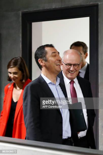 Coleaders of the Germany Greens Party Cem Ozdemir and Katrin GoeringEckardt leave with Volker Kauder of the CDU after members of the delegations of...