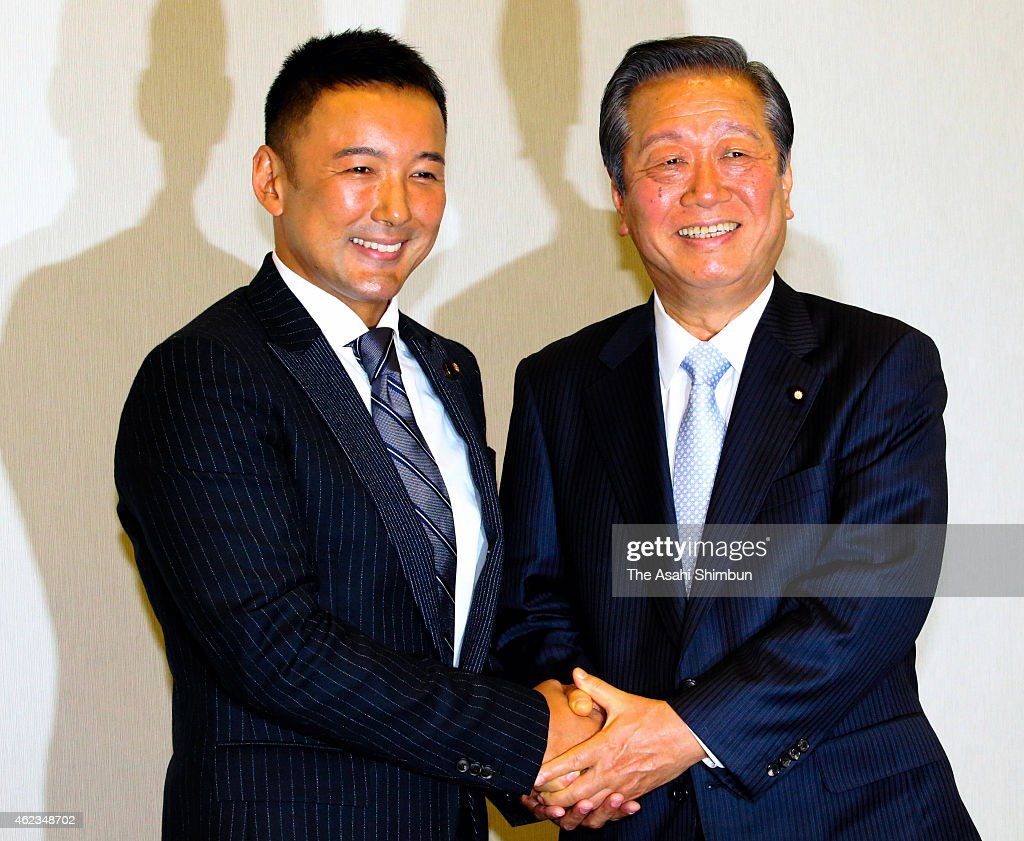 Co-Leaders <a gi-track='captionPersonalityLinkClicked' href=/galleries/search?phrase=Taro+Yamamoto&family=editorial&specificpeople=4614809 ng-click='$event.stopPropagation()'>Taro Yamamoto</a> (L) and <a gi-track='captionPersonalityLinkClicked' href=/galleries/search?phrase=Ichiro+Ozawa&family=editorial&specificpeople=680192 ng-click='$event.stopPropagation()'>Ichiro Ozawa</a> shake hands during 'The People's Life Party & <a gi-track='captionPersonalityLinkClicked' href=/galleries/search?phrase=Taro+Yamamoto&family=editorial&specificpeople=4614809 ng-click='$event.stopPropagation()'>Taro Yamamoto</a> And Friends' press conference on January 27, 2015 in Tokyo, Japan.