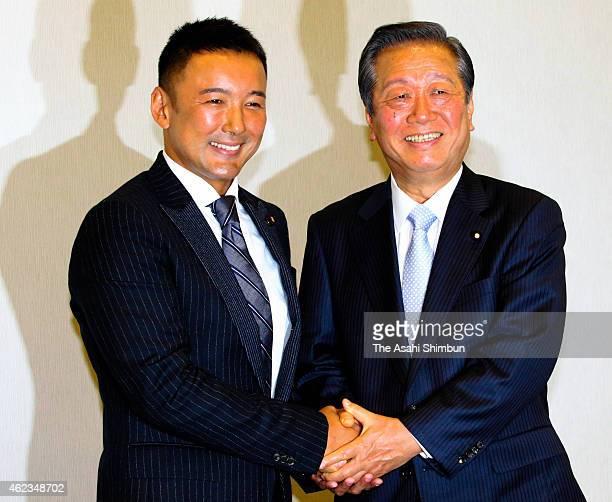 CoLeaders Taro Yamamoto and Ichiro Ozawa shake hands during 'The People's Life Party Taro Yamamoto And Friends' press conference on January 27 2015...