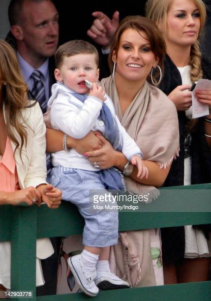 Coleen Rooney and her son Kai Rooney watch the John Smith's Grand National horse race at Aintree Racecourse on April 14 2012 in Liverpool England