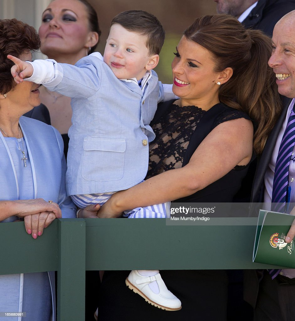Coleen Rooney and her son <a gi-track='captionPersonalityLinkClicked' href=/galleries/search?phrase=Kai+Rooney&family=editorial&specificpeople=6932235 ng-click='$event.stopPropagation()'>Kai Rooney</a> watch the racing as they attend the John Smith's Grand National at Aintree Racecourse on April 6, 2013 in Liverpool, England.