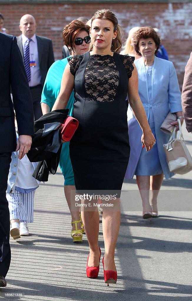 Coleen Rooney and mother Colette McLoughlin (L) attend the Grand National Day at Aintree on April 6, 2013 in Liverpool, England. Millions of pounds are being wagered on the 40 runners taking part in Europe's richest jump race the 166th Grand National.