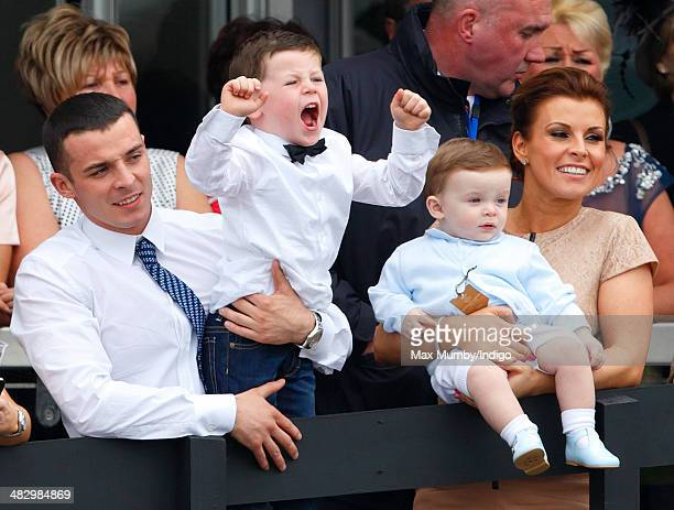 Coleen Rooney and sons Kai Rooney and Klay Rooney watch the racing as they attend the Crabbie's Grand National horse racing meet at Aintree...