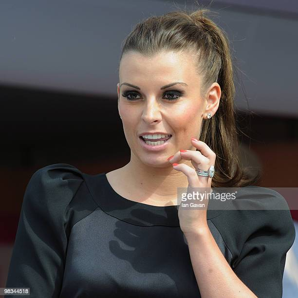 Coleen Rooney attends Ladies' Day at Aintree Racecourse on April 9 2010 in Liverpool England