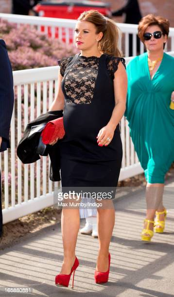 Coleen Rooney attends the John Smith's Grand National at Aintree Racecourse on April 6 2013 in Liverpool England