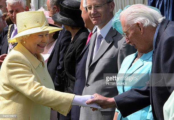 Britain's Elizabeth II greets Northern Ireland's new First Minister Ian Paisley during a garden party at the University of Ulster campus in Coleraine...