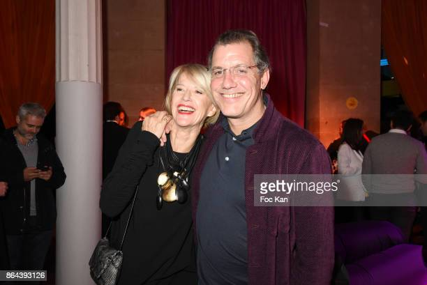 Colette Barbier and a guest Laurent attend the 'Bal Jaune Elastique 2017' Dinner Party at Palais Brongniart on October 20 2017 in Paris France