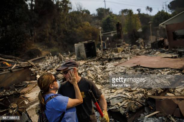 Colette Lipscomb embraces her husband Jeff Lipscomb and asks if he's ok as the family returns to their destroyed home to survey the damage after a...