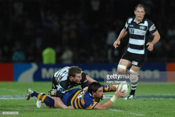 Colin Bourke of Bay of Plenty tries to keep the ball alive in a tackle in the Air New Zealand Cup match between the Hawkes Bay and Bay of Plenty at...