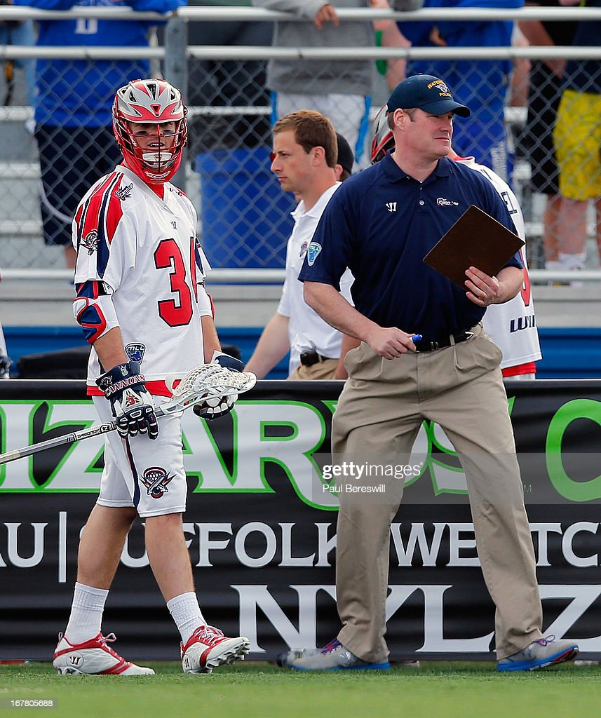 Colin Briggs #34 of the Boston Cannons waits to get into the game as head coach Steve Duffey watches the action during a Major League Lacrosse game against the New York Lizards at James M. Shuart Stadium on April 28, 2013 in Hempstead, New York.