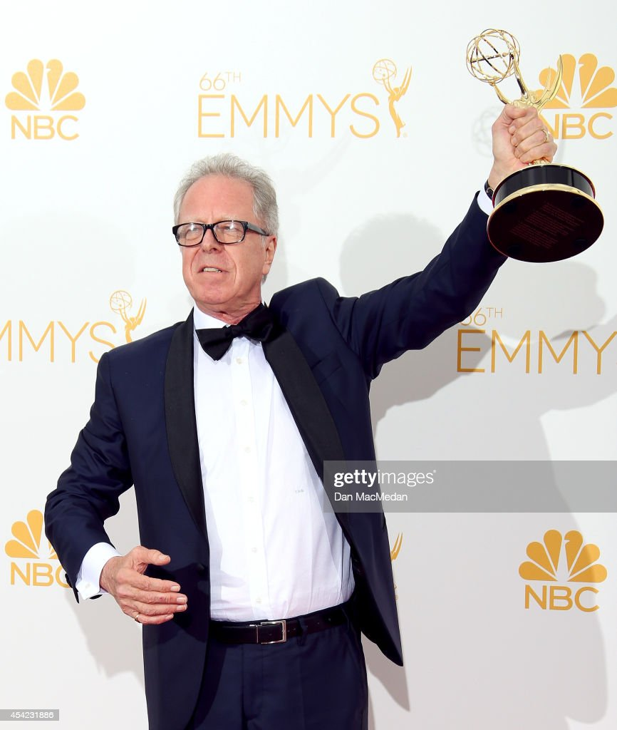 Colin Bucksey poses in the photo room with his award for Outstanding Directing for a Miniseries, Movie or a Dramatic Special for 'Fargo' at Nokia Theatre L.A. Live on August 25, 2014 in Los Angeles, California.