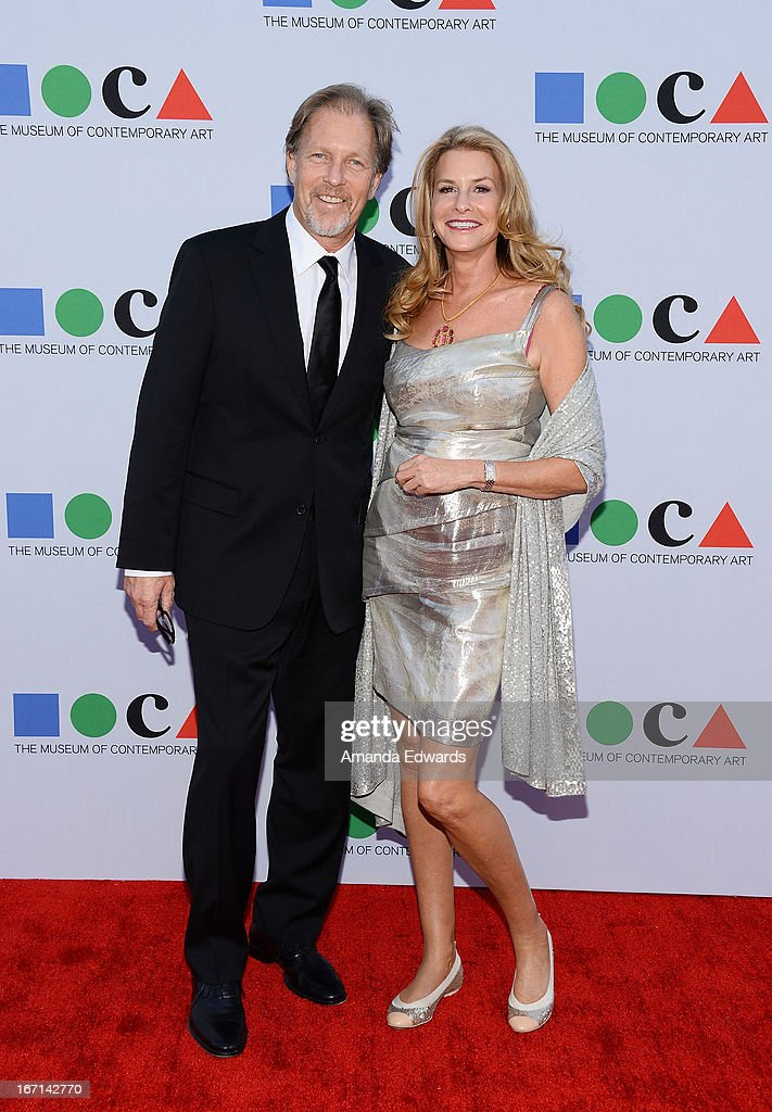Colin Burns (L) and Pamela West arrive at the 'Yesssss!' 2013 MOCA Gala, celebrating the opening of the exhibition Urs Fischer at MOCA Grand Avenue on April 20, 2013 in Los Angeles, California.